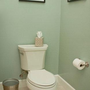 Идея дизайна: маленькая ванная комната в морском стиле с фасадами в стиле шейкер, фасадами цвета дерева среднего тона, душем над ванной, унитазом-моноблоком, белой плиткой, синими стенами, полом из травертина, врезной раковиной, столешницей из искусственного кварца, бежевым полом и душевой кабиной