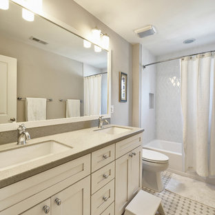 Elegant white tile bathroom photo in Philadelphia with an undermount sink, shaker cabinets and white cabinets