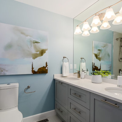 Example of a mid-sized transitional beige tile and ceramic tile ceramic tile bathroom design in Vancouver with shaker cabinets, gray cabinets, a two-piece toilet, blue walls and an undermount sink