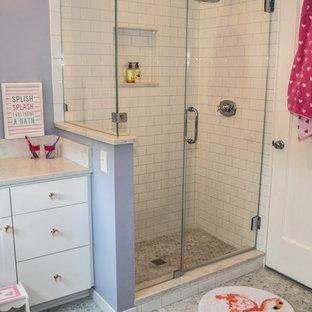 Cette photo montre une petit salle de bain romantique pour enfant avec un placard en trompe-l'oeil, des portes de placard blanches, une douche d'angle, un WC séparé, un carrelage blanc, un carrelage métro, un mur bleu, un sol en marbre, un lavabo encastré, un plan de toilette en quartz modifié, un sol gris, une cabine de douche à porte battante et un plan de toilette blanc.
