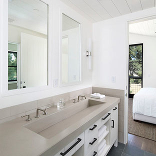 Small country beige tile and ceramic tile slate floor and gray floor bathroom photo in San Francisco with white cabinets, white walls, a trough sink and concrete countertops