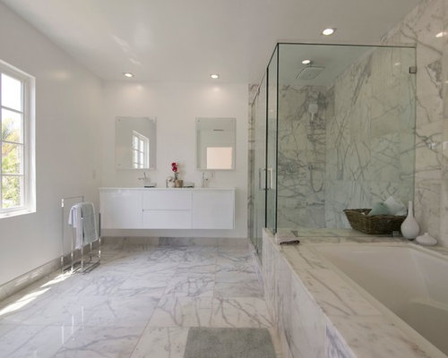 Inspiration for a contemporary white tile and marble tile marble floor  alcove shower remodel in Los