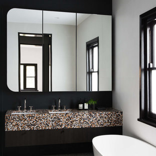 Photo of a contemporary bathroom in Melbourne with multi-coloured benchtops, a freestanding tub, white walls, an undermount sink and grey floor.