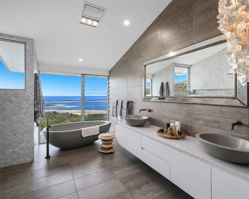 Design Ideas For A Tropical Master Bathroom In Central Coast With  Flat Panel Cabinets,