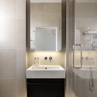 Photo of a medium sized contemporary shower room bathroom in London with flat-panel cabinets, black cabinets, an alcove shower, beige tiles, porcelain tiles, porcelain flooring, an integrated sink, beige floors, white worktops, a single sink and a floating vanity unit.