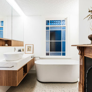 Photo of a mid-sized contemporary master bathroom in Sydney with medium wood cabinets, a freestanding tub, white walls, concrete floors, a vessel sink, beige floor, white benchtops, furniture-like cabinets, an alcove shower, a one-piece toilet, white tile, ceramic tile, engineered quartz benchtops and an open shower.