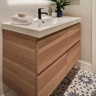 Bathroom - small contemporary gray tile and ceramic tile cement tile floor, blue floor and single-sink bathroom idea in Chicago with flat-panel cabinets, light wood cabinets, a two-piece toilet, gray walls, a wall-mount sink, white countertops, a niche and a floating vanity