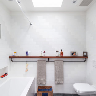 Urban white tile tub/shower combo photo in Toronto