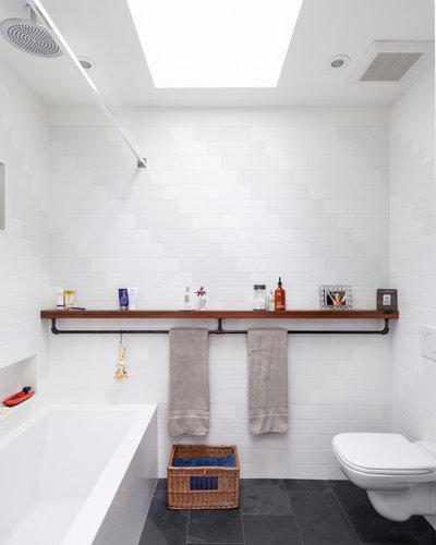 Industrial Bathroom by Wanda Ely Architect Inc.