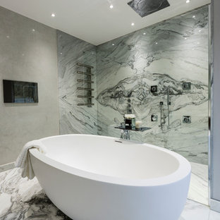 Example of a trendy gray tile, white tile and marble tile marble floor bathroom design in Surrey with gray walls