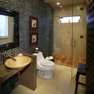 Inspiration for a world-inspired bathroom in Las Vegas with a vessel sink and pebble tiles.