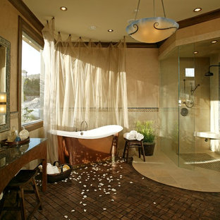 Mediterranean bathroom in Las Vegas with a built-in shower, a freestanding bath, mosaic tiles and brick flooring.