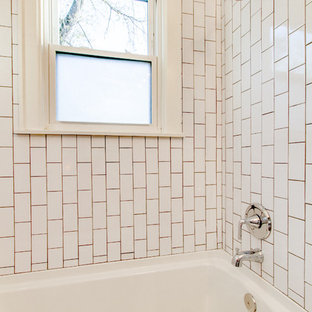 Example of a mid-sized minimalist white tile and ceramic tile marble floor and gray floor bathroom design in Nashville with flat-panel cabinets, brown cabinets, a one-piece toilet, white walls and a vessel sink