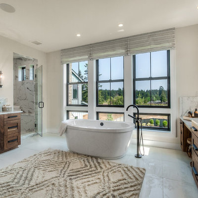 Inspiration for a transitional master white floor bathroom remodel in Seattle with an undermount sink, a hinged shower door, gray countertops, shaker cabinets, dark wood cabinets and gray walls