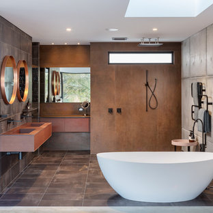 Inspiration for a large industrial master bathroom in Perth with flat-panel cabinets, brown cabinets, a freestanding tub, an open shower, multi-coloured tile, multi-coloured walls, ceramic floors, brown floor, a wall-mount sink and an open shower.