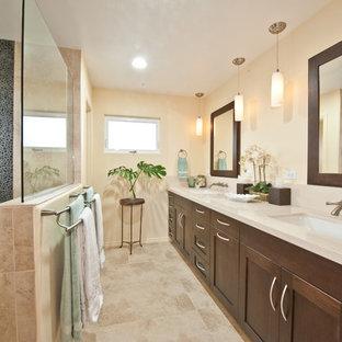 Immagine di una stanza da bagno padronale classica di medie dimensioni con lavabo sottopiano, ante in stile shaker, top in superficie solida, doccia aperta, piastrelle beige, pareti beige, pavimento in travertino, ante in legno bruno, pavimento beige e doccia aperta