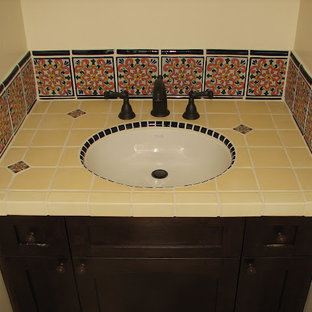Inspiration for a medium sized mediterranean shower room bathroom in Sacramento with shaker cabinets, dark wood cabinets, an alcove shower, black tiles, multi-coloured tiles, yellow tiles, ceramic tiles, beige walls, an integrated sink, tiled worktops, an open shower and yellow worktops.