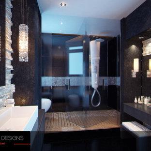Esempio di una grande stanza da bagno padronale minimalista con lavabo a consolle, ante di vetro, ante in legno chiaro, top in legno, vasca ad alcova, WC sospeso, piastrelle nere, piastrelle a mosaico, pareti grigie e pavimento con piastrelle in ceramica