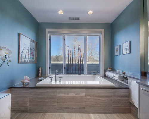 contemporary bathroom idea in denver with a drop in tub and blue walls