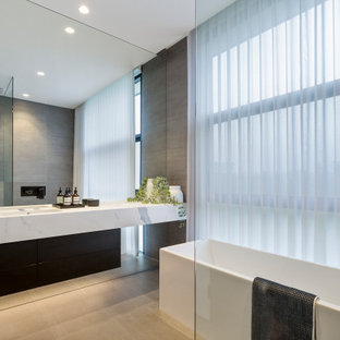 This is an example of a contemporary bathroom in Adelaide with porcelain tile and porcelain floors.
