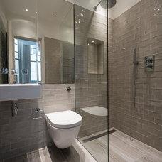 Modern Bathroom by TLA Studio