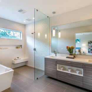 Example of a trendy master white tile and porcelain tile bathroom design in Los Angeles with an undermount sink, flat-panel cabinets, gray cabinets, engineered quartz countertops and white walls