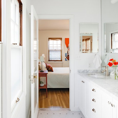 Mid-sized elegant master white tile and ceramic tile ceramic tile alcove shower photo in Portland with an undermount sink, white cabinets, recessed-panel cabinets, a two-piece toilet, white walls, marble countertops and white countertops