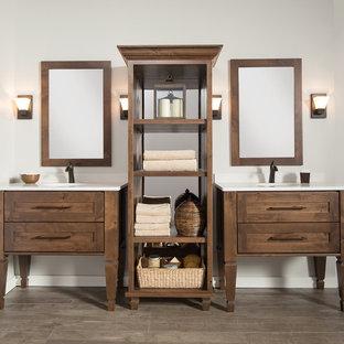 Idée de décoration pour une salle de bain principale tradition de taille moyenne avec un lavabo encastré, des portes de placard en bois brun, un plan de toilette en surface solide, un mur gris, un sol en bois brun, un carrelage blanc, un sol gris, un plan de toilette blanc et un placard en trompe-l'oeil.