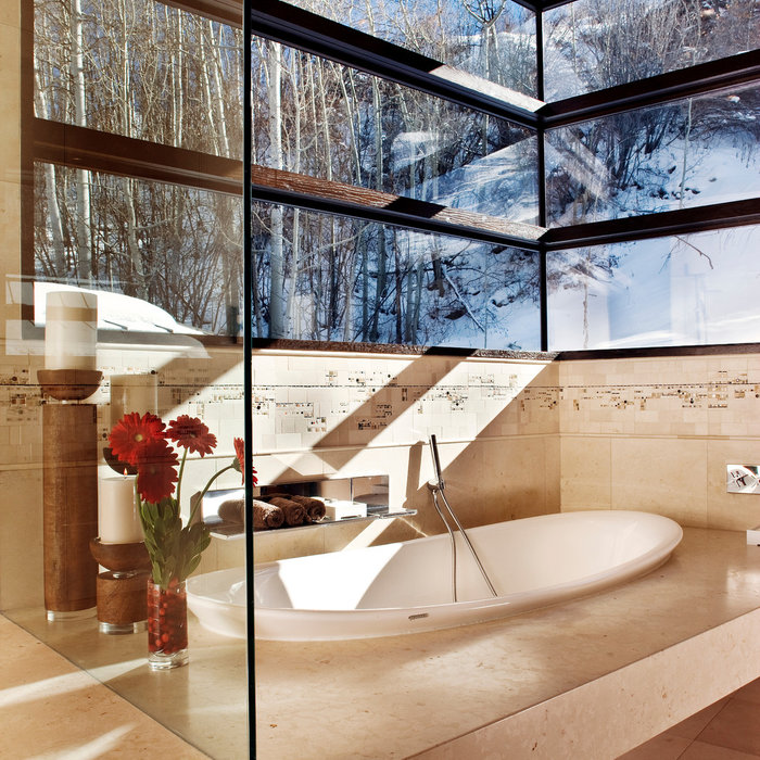 Master bathrooms are surrounded by windows filling the rooms with light and bringing the Aspen landscape indoors. Soaking tubs and steam showers add to the luxury.