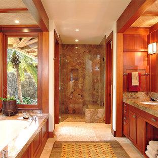 Idées déco pour une douche en alcôve principale exotique de taille moyenne avec un lavabo encastré, un placard à porte shaker, des portes de placard en bois brun, une baignoire encastrée, un carrelage marron, des dalles de pierre, un mur blanc, un sol en travertin, un sol beige, une cabine de douche à porte battante et un plan de toilette gris.