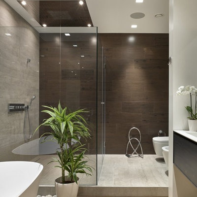 Freestanding bathtub - mid-sized contemporary master light wood floor freestanding bathtub idea in Moscow with flat-panel cabinets, dark wood cabinets and a wall-mount toilet
