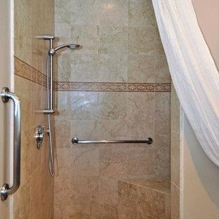 На фото: ванная комната среднего размера в современном стиле с плоскими фасадами, фасадами цвета дерева среднего тона, душем над ванной, раздельным унитазом, разноцветной плиткой, галечной плиткой, бежевыми стенами, полом из травертина, душевой кабиной, врезной раковиной и столешницей из гранита