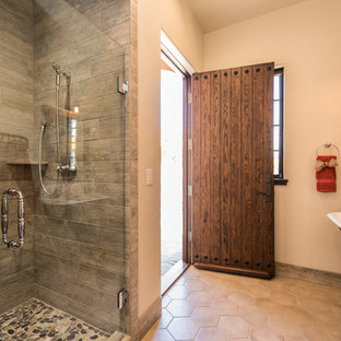Tuscan 3/4 gray tile alcove shower photo in Portland with a trough sink and a hinged shower door