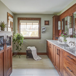 Example of an arts and crafts master beige floor bathroom design in Chicago with medium tone wood cabinets, gray walls, an undermount sink and white countertops