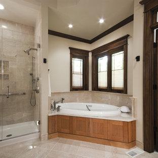 Idée de décoration pour une douche en alcôve tradition avec un placard à porte shaker, des portes de placard en bois brun, une baignoire posée et un carrelage beige.