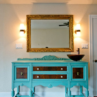 Inspiration for a large mediterranean 3/4 terra-cotta tile terra-cotta floor bathroom remodel in Houston with a vessel sink, furniture-like cabinets, turquoise cabinets, wood countertops, beige walls and turquoise countertops