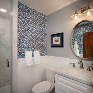 Small nautical shower room in San Francisco with a submerged sink, raised-panel cabinets, white cabinets, marble worktops, an alcove shower, a two-piece toilet, white tiles, stone tiles and multi-coloured walls.