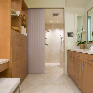 Inspiration for a mid-sized contemporary master beige tile limestone floor alcove shower remodel in San Diego with an undermount sink, flat-panel cabinets, medium tone wood cabinets, beige walls, quartzite countertops and beige countertops