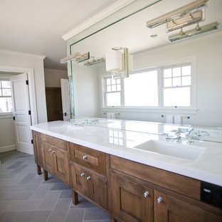 Inspiration for a timeless stone tile bathroom remodel in San Diego with an undermount sink, shaker cabinets and dark wood cabinets