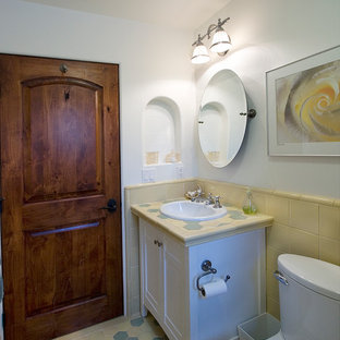 Bathroom - small victorian multicolored tile and ceramic tile ceramic floor bathroom idea in San Diego with a drop-in sink, furniture-like cabinets, white cabinets, tile countertops, a two-piece toilet and white walls