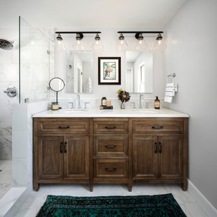 Photo of a mid-sized country master bathroom in San Francisco with furniture-like cabinets, distressed cabinets, an alcove shower, a two-piece toilet, multi-coloured tile, marble, grey walls, marble floors, a drop-in sink, engineered quartz benchtops, grey floor and a hinged shower door.