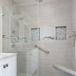 Example of a small beach style master gray tile and porcelain tile porcelain tile and gray floor bathroom design in San Diego with recessed-panel cabinets, white cabinets, a two-piece toilet, gray walls, an undermount sink and quartzite countertops