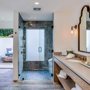 Tuscan master blue tile and gray tile dark wood floor and brown floor alcove shower photo in Los Angeles with flat-panel cabinets, medium tone wood cabinets, white walls, an undermount sink, a hinged shower door and brown countertops