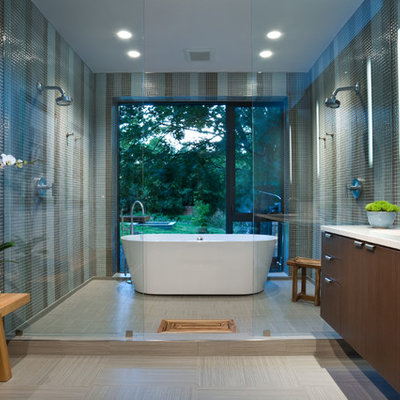 Example of a trendy green tile and mosaic tile bathroom design in Dallas with an undermount sink, flat-panel cabinets and dark wood cabinets