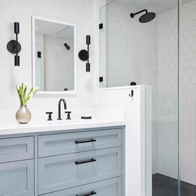Transitional master white tile and ceramic tile ceramic tile and gray floor double shower photo in San Francisco with shaker cabinets, blue cabinets, white walls, an undermount sink, quartz countertops, a hinged shower door and white countertops
