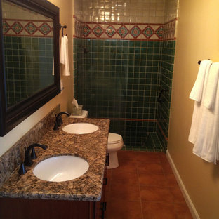 Medium sized mediterranean shower room in Orange County with dark wood cabinets, an alcove shower, green tiles, multi-coloured tiles, ceramic tiles, brown walls, terracotta flooring, a submerged sink, granite worktops, brown floors, an open shower and brown worktops.