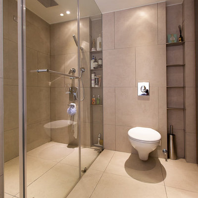 Inspiration for a contemporary walk-in shower remodel in Other with a wall-mount toilet