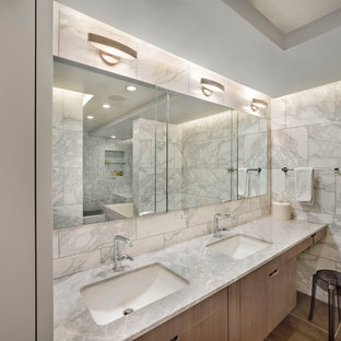 Example of a mid-sized trendy master white tile and marble tile porcelain floor bathroom design in New York with an undermount sink, flat-panel cabinets, light wood cabinets, white walls and marble countertops