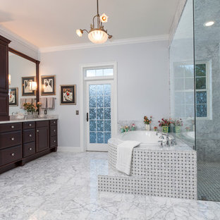 Bathroom - large traditional master white tile and stone tile marble floor bathroom idea in Orlando with raised-panel cabinets, dark wood cabinets, an undermount sink, marble countertops, a one-piece toilet and purple walls