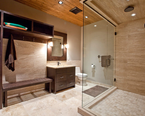 A Large Masculine Bathroom With Black Stratosphere The Shower Area Is Enclosed Gl